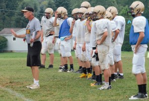 MAKING ADJUSTMENTS during pre-season practices is Curwensville Area head coach Andy Evanko.  (photo by Rusty McCracken)