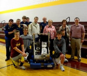 Pictured, kneeling from left to right, are Joshua Scileski, Alan Brennan, 2013 Deadlox Robot, The LOXsmith, Joseph Messineo and Joel Brennan, who are all students at Elk County Catholic.   Standing, in back from left to right, are Crystal Rishell, Deadlox mentor, Jessica Szejk, Deadlox team member, Andrew Wells, Deadlox team member, Padon Rishell, Deadlox team member, CJ Kogovsek, ECCSS board of directors, Dave Rishell, Deadlox mentor, Mary Agnes Marshall, ECCSS president, Sandy Florig, ECCSS principal and Dane Peterson, ECCSS computer technician. (Provided photo)