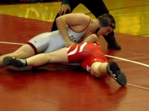 Sophomore Nate Lash picks up his varsity pin for the Bison (Photo by Jessica Shirey).