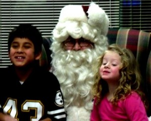 Santa Claus visits with Denis and Elli Swales and informs them that they made his nice list this year. (Provided photo)