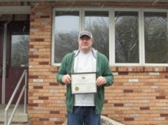 Pictured is Forester Tom Asp with his 10 years of service award. (Provided photo)
