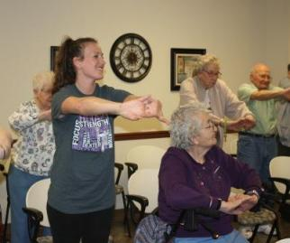 Penn State DuBois OTA student Jen Marks leads residents of Village View Residential Living and DuBois Village Personal Care home in exercises as part of a fall prevention program.  Seated is Kathleen Tribout, and behind Marks, left to right, are Pat McIntosh, Retha Lupro, and Tom Anderson. (Provided photo)