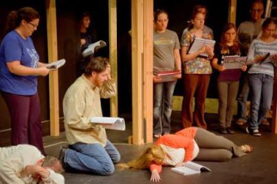 The cast of Sweeney Todd rehearses a dramatic scene at the Reitz Theater in DuBois. Pictured, from left to right, are Kristie Taylor (Mrs. Lovett), Chris Taylor (Sweeney Todd), Charles Brosius (behind Todd), Nicki Cherry, Krista Carr, Jacqueline Spicher, Allan Hewitt and Caitlin Kalgren. (Provided photo)