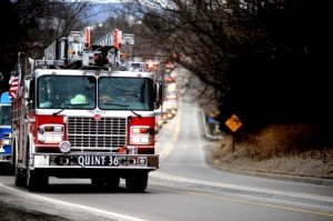 """West Sandy Hose Company's """"Quint 36"""" was one of the hundreds of units in the funeral procession for fallen firefighter Jeffrey Buck Jr. (Photo by Mark Kolash)"""