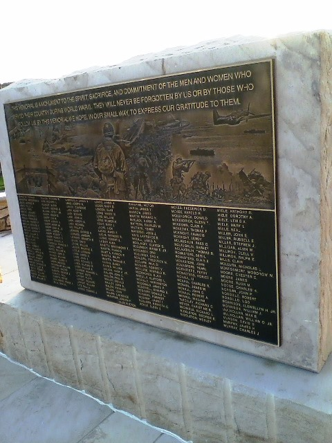The center stone of the new WWII Memorial features a detailed drawing of men in action in addition to some of the names of those who served in the war. There are three stones in all with a total of 993 names. The memorial was designed by Jennie Ryan-Gisewhite. (Photo by Julie Rae Rickard)