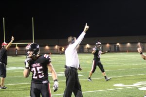 Head coach Tim Janocko signalling for the extra point following what ultimately was the game-winning touchdown.