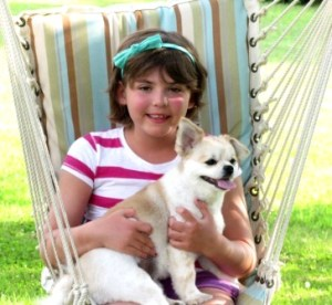 Emily Whitehead enjoying her summer vacation with her dog, Lucy. (Photo by Theresa Dunlap)
