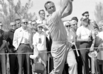 Arnold Palmer receives his winnings in silver dollars at the 1965 Tournament of Champions golf tournament at the Desert Inn Country Club in Las Vegas.