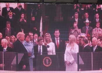 Donald Trump is surrounded by his family taking the oath of office from Chief Justice Roberts. (Photo by Wendy Brion).