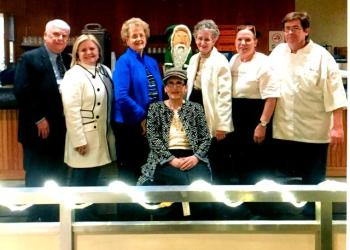 Last year Hoodie Hoo helped waitress, Cindy Hooven, with medical expenses.  This year, she and her boss, Perry Centra, would like to thank Hoodie Hoo at the Elk's Buffet on Sunday, Feb. 19 from 11 a.m. – 3 p.m. In the back row are Alan Walker, Judy Walker, Joanne Meyers, Hoodie Hoo, Donna Shaw, Hooven and Centra. In the front is Jane Lee Yare. (Provided photo)