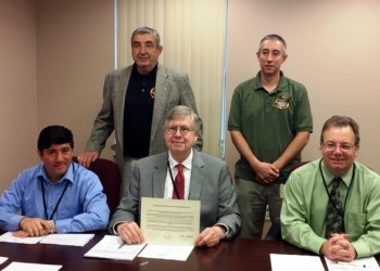 Shown are Emergency Management Agency Director Joe Bigar and 911 Coordinator Jeremy Ruffner with Clearfield County Commissioners Tony Scotto, John A. Sobel and Mark B. McCracken. (Photo by Jessica Shirey)