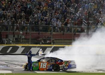 """Marking the 25th Anniversary of the first night race at Charlotte, Kyle Busch had his own """"One Hot Night,"""" taking home $1 million for victory."""