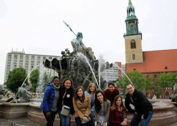 Pictured in front, left to right, are Associate Professor of Economics Evelyn Wamboye and Career Services Coordinator Anna Akintunde, with students Cortney Hedlund, Cintia Zwick, Lisa Sargent and Austin Sabatucci. In back, from left to right, are students Cathy Provost and Saisree Medapally. The group captured this photo at Neptune Fountain, in front of Rotes Rathaus (the city hall in Berlin). The Roman god Neptune is in the center. The four women around him represent the four main rivers of Prussia at the time the fountain was constructed in 1891. (Provided photo)