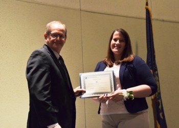 Halee Kephart Chase of Brisbin was presented with a certificate of graduation by Dr. Dennis Calvin, associate dean and director of Penn State Extension. (Provided photo)