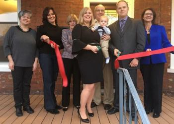 Shown are Owners Heather L. and Robert Bozovich and son, Connor Bozovich. Also, shown are Main Street Manager Loretta Wagner, Lori Roberts, JoAnn Gilson, Frank Blum and Annette Bozovich. Clearfield Borough Operations Manager Leslie Stott was present but not in the photo. (Provided photo)
