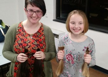 THON Dancer Julie Test, left, and nine-year-old Kendall Lashinsky both committed to donating the hair they had cut at the THON Hair Auction to organizations that make real-hair wigs for those dealing with illness related hair loss. (Provided photo)
