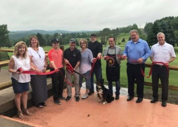 Shown, from left, are:  Kim McCullough, Chamber director; Dawn Shaw, Helmbold & Stewart; Dayton, Teresa and James Skinner;  Rick Wean, Eagles Ridge chef; Kenn Starr, Starr Hill Vineyard & Winery; Kevin Wain, chair, CNB; and Mike Ryan, Northwest Bank. (Provided photo)