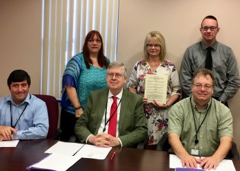 Pictured, in front, are Clearfield County Commissioners Tony Scotto, Chairman John A. Sobel and Mark B. McCracken. In the back are Crossroads Director Suella Himes, Counselor/Legal Advocate Tammy Kyler and Domestic Violence Services Coordinator Shawn Day. (Photo by GANT News Editor Jessica Shirey)