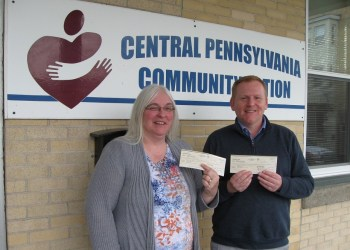 Shown are Donna Gill, CPCA family services supervisor, and Ned Kendall III, FirstEnergy, manager external affairs. (Provided photo)