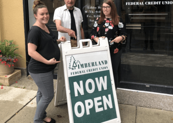 Pointing to the news that Timberland Federal Credit Union is now open in the historic Moshannon Building at the corner of Front and Pine streets in Philipsburg are Mariah Pearson, member relations officer; Luther Gette, curator of the Philipsburg Historical Foundation, new owners of the Moshannon Building; and Stephanie Bagshaw, operations manager of TFCU. (Provided photo)
