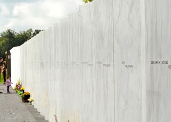 Visitors pay their respects to the 40 passengers and crew members at the Wall of Names.  NPS photo