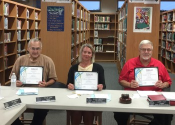 During Monday night's meeting, three school board members were recognized by Erin Eckerd, a representative of the Pennsylvania School Board Association. Board President Larry Putt (right) was recognized for 16 years of service while board members Phil Carr (left) and Susan Mikesell (center) were recognized for having 12 years of service. (Photo by GANT News Editor Jessica Shirey)