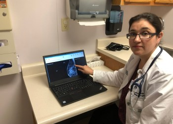 October is Breast Cancer Awareness Month and a time to remind loved ones – including ourselves – about having annual mammograms. Early detection is best. Shown is Dr. Lisa Coughlin, general surgeon at Penn Highlands Healthcare, reviewing an image of a breast. General surgeons are often needed should a biopsy or more need to be done. (Provided photo)