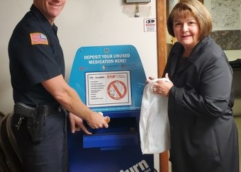 Area resident Toni Houston brings unwanted medication to the Brockway Borough Police Department during National Prescription Take Back Day on Oct. 26. Also pictured is Brockway Police Department Chief Terry Young.  (Provided photo)