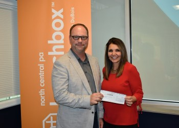 North Central PA LaunchBox Director Brad Lashinsky receives a $15,000 donation presented by First Commonwealth Bank-Trust Assistant Vice President and Trust Officer Lisa LaBue on behalf of the Glenn and Ruth Mengle Foundation. (Provided photo)