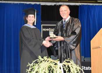Assistant Teaching Professor LuAnn Demi receives her DEF Educator of the Year Award from DEF president Craig Ball during spring commencement ceremonies at Penn State DuBois.  (Provided photo)
