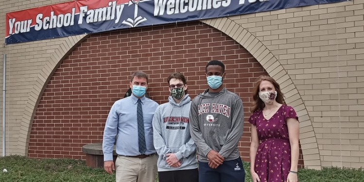 Shown are LHU alumni Andrew (left end) and Lauren Rice (right end) and incoming LHU freshmen Derek Strouse (middle left - nursing, Clearfield campus) and Loren Way (middle right - health and physical education, Lock Haven campus) outside of DuBois Central Catholic, where Strouse and Way are seniors and Andrew (08) and Lauren (07) teach. Now DuBois Central Catholic students will be able to enroll in LHU courses as part of the university's dual enrollment program.  (Provided photo)