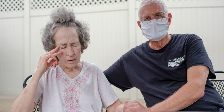 Pat Loughney (right) cared for his wife, Candy, in their home until she became ill after eating medicated soap. Candy is one of 280,000 Pennsylvanians over the age of 64 living with Alzheimer's disease, the most common cause of dementia.  Quinn Glabicki for Spotlight PA / PublicSource