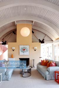 GAP Interiors - Modern living room with vaulted ceilings ...