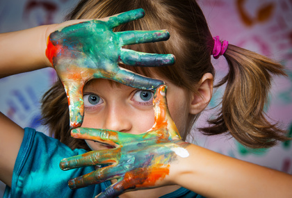 Image of little girl with different colors painted on her hands