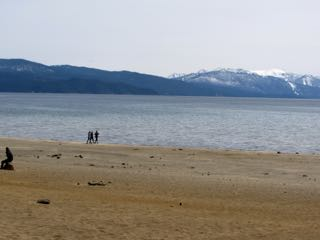 Image of Kings beach with snow capped mountains in the background