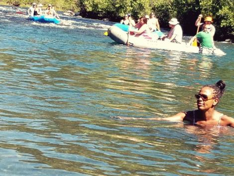 Image of woman swimming in Truckee River