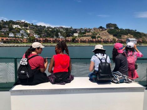 5 women on a Ferry on their way from Angel Island having a conversation