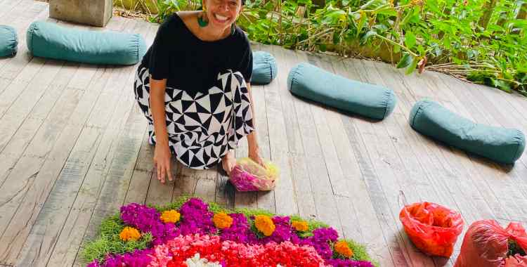 Image of woman smiling in front of a beautiful hand made flower heart