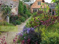 GAP Gardens - A gravel path between a double herbaceous ...