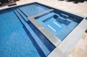 gunite pool with overflolw spa