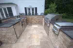 gunite swimming pool with spill-over spa , patio and outdoor kitchen with twin eagle appliances.NEF