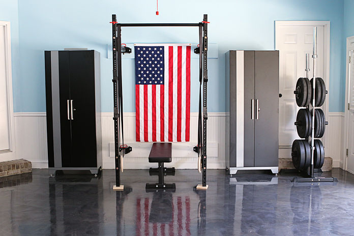 Clean Garage Gym with American Flag and Black Power Rack