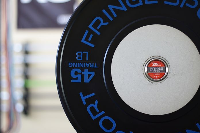 Fringe Sport Competition Training Bumper Plate Closeup Garage Gym Lab