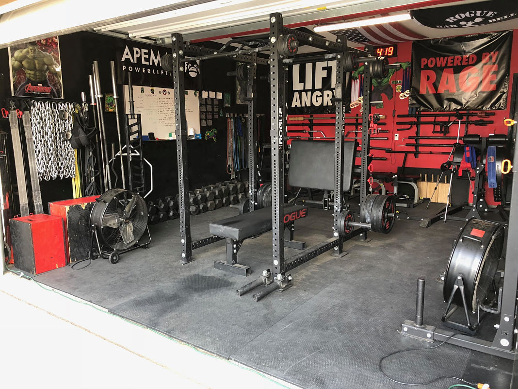 Step into this retired marines pain cave garage gym lab
