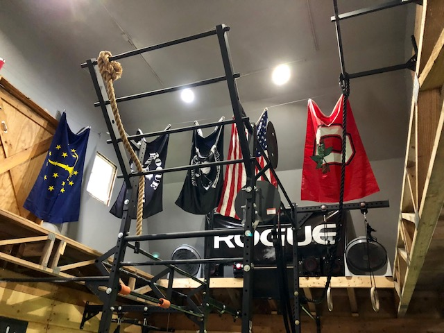 Rogue folding rig bumper weights the garage gym in