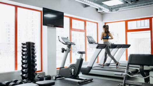 woman doing exercises on the treadmill