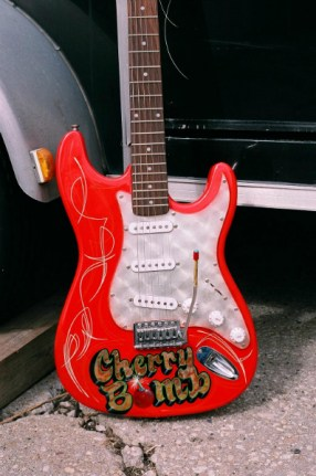 I love doing the guitars. Gold leaf and striping, this one is in my collection.