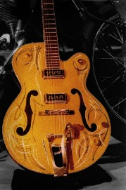 This was a stunning gold metal flaked Gretsch guitar. I striped it with white and black for a traditional 50's look.