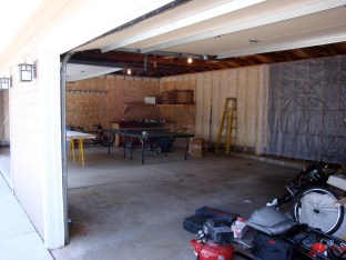 This garage door opening is the parking side, closer to the house, looking toward the workshop.