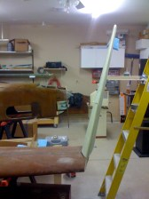 Winglet roughly set into place using a wood stick and ladder to hold the winglet.